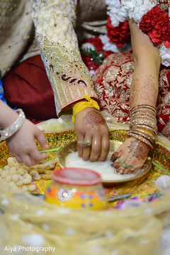 Indian wedding ceremony milk ritual.