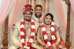 Sweet indian couple posing with best man.