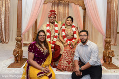 Dazzling indian couple with family .
