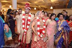Indian couple's wedding ceremony ending.