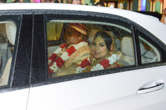 Lovely Indian bride and groom leaving ceremony.