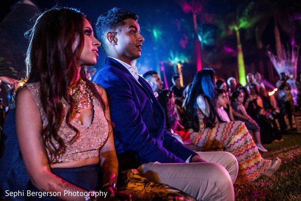 Surprised Indian couple at sangeet party.