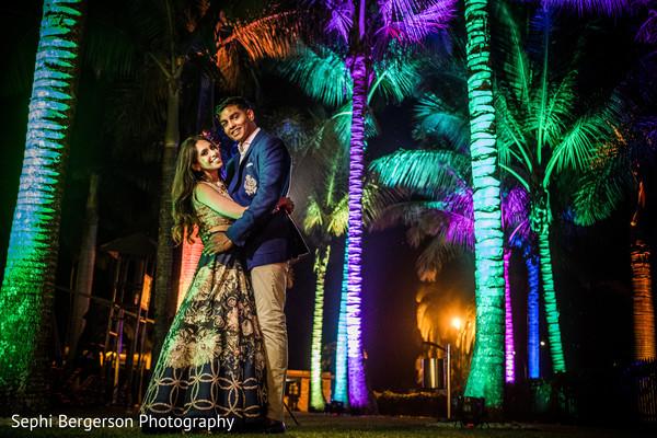 Joyful Indian couple outdoors photo session.