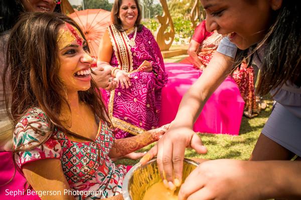 Maharani getting past at haldi ritual.