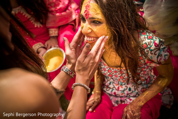 Joyful pithi celebration for Indian bride.
