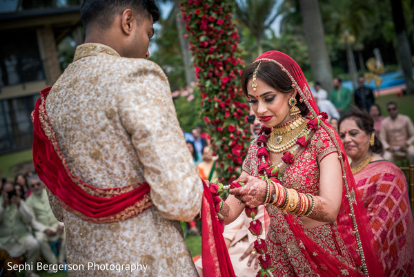 Indian bride about to put garland to groom.
