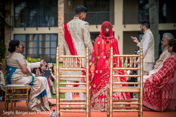 Gorgeous Indian couple with family at the wedding ceremony.