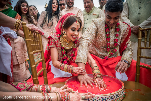 Indian bride and groom looking at bracelets ritual.