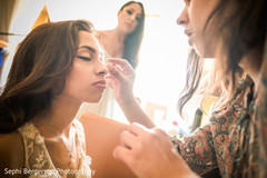 Indian bride getting her makeup done.