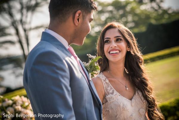 Joyful Indian bride looking at groom.