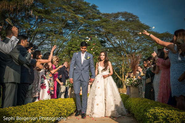 Indian bride and groom walking out of wedding ceremony.