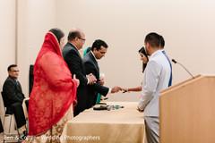 Indian bride getting her wedding ring capture.