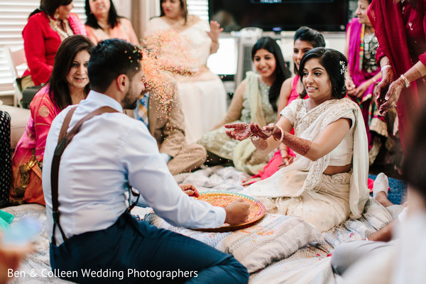 Indian bride fun moment at ceremony capture.