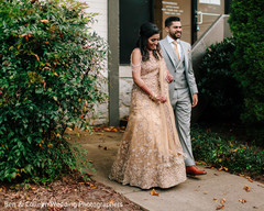 Indian couple walking outdoors capture.
