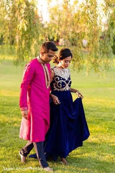 Indian couple walking outdoors.