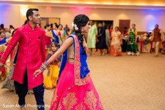 Lovely Indian couple during sangeet dance capture.