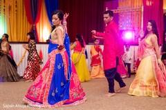 Incredible Indian couple at sangeet dance capture.