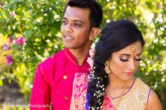 Enchanting Indian couple posing outdoors.