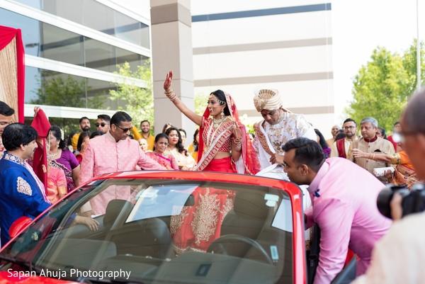 Indian bride waving goodbye.