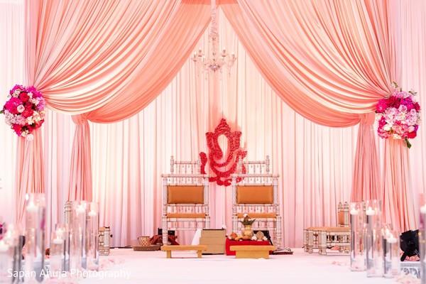 Marvelous mandap draping decor and flowers.