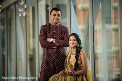 Indian bride and groom looking enchanting