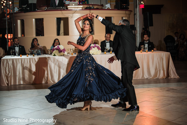 Indian bride having her first dance with Raja