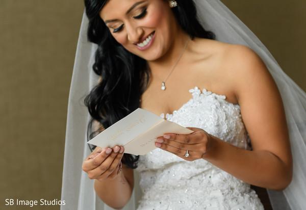 Indian bride reading grooms postcard.