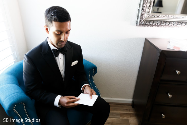 Indian groom reading bride's letter.