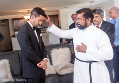 Indian groom being blessed.