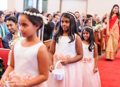 Lovely Indian flower girls making their entrance to ceremony.
