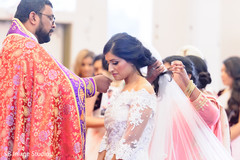 Take a look at this lovely Indian bride at her wedding ceremony.