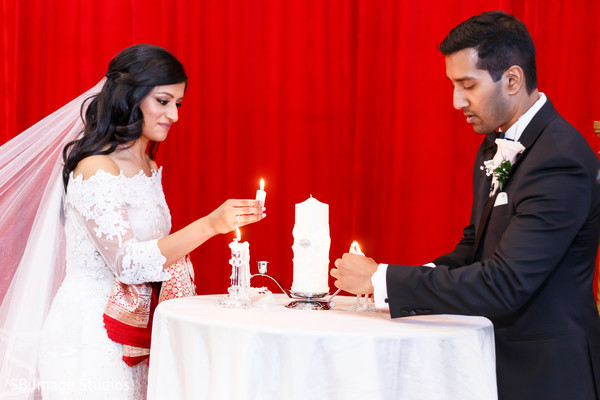 Indian couple lighting up the fire at ceremony.