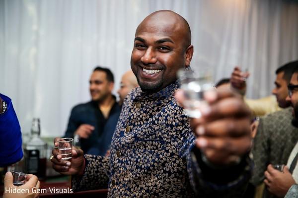 Raja having a drink during the pre-wedding ceremonies