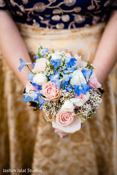 Indian bridesmaid holding the bouquet