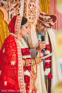 Indian groom reading his vows