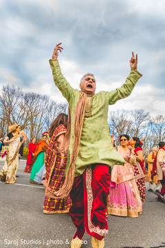 Indian guest having fun during baraat