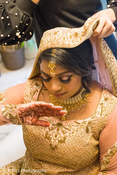 Gorgeous bride showing her mehndi