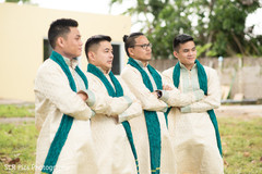 Groomsmen posing for pictures