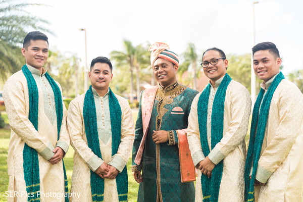 Raja posing with groomsmen prior to the ceremony