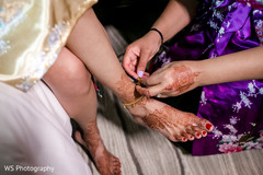 Indian bride getting her anklets on.