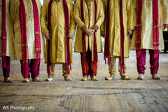 Creative capture of rajah and groomsmen on ceremony outfits
