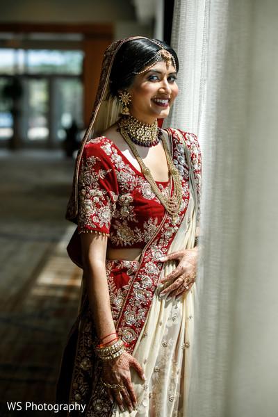 Dazzling Indian bride ceremony look.