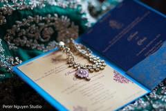 Indian bridal kundan and wedding invitations.