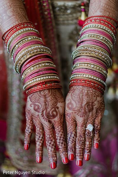 Maharani showing her henna art.