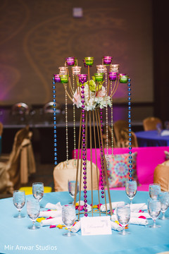Colorful Sangeet table centerpiece decor.