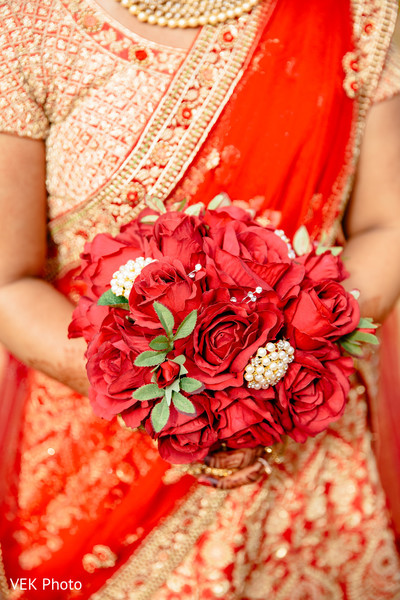 Stunning Indian bridal red roses bouquet.