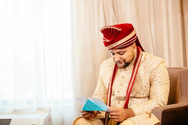 Indian groom reading maharanis letter.