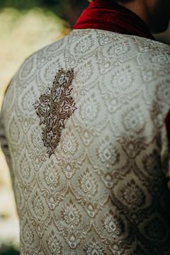 Detailed embroidery on rajahs sherwani.