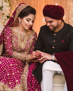 Indian bride putting ring to groom photo.