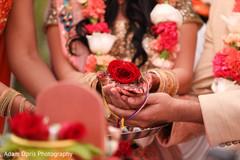 Indian couple closeup of wedding ceremony ritual.